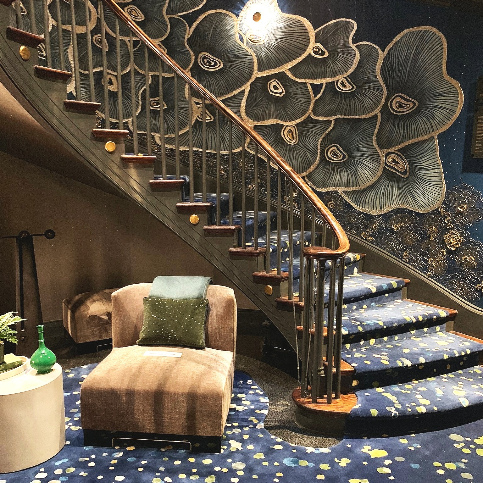 Richard Rabel Interiors and Art Ltd . Entry Gallery and Grand Lower Staircase. The rug was created without knowing that it would so perfectly echo the droplet effect created by the 4-story-spanning mobile above.