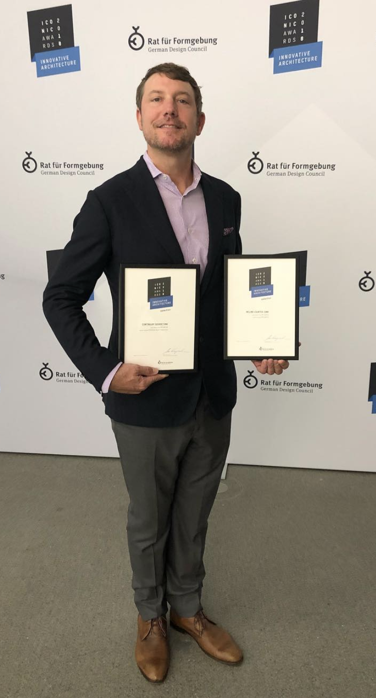 President and CCO Russell Adams last fall with MTI's 2  Iconic Design awards