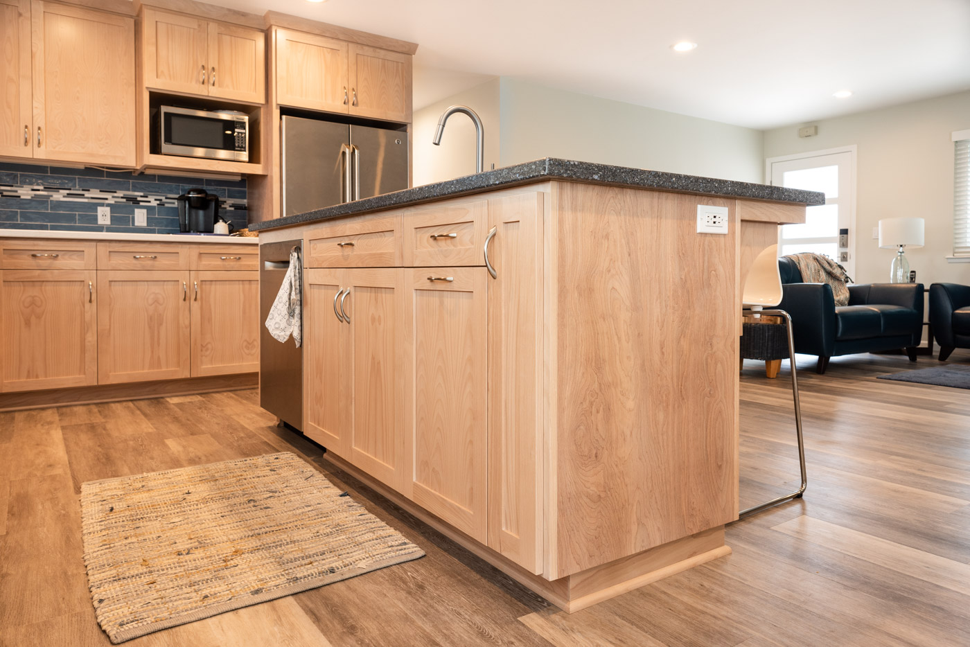Coastal Contemporary custom kitchen cabinets with natural wood stain and custom island