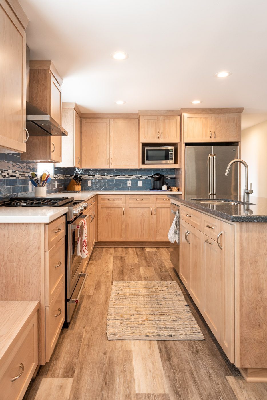 Coastal Contemporary custom kitchen cabinets with natural wood stain