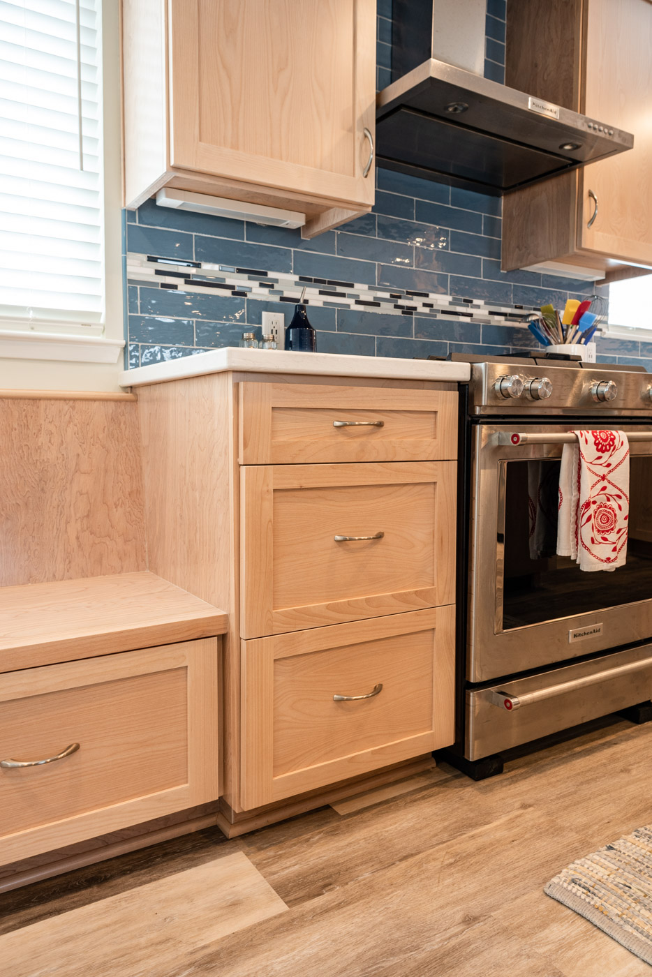 Coastal Contemporary custom kitchen cabinets with natural wood stain and drawer bank