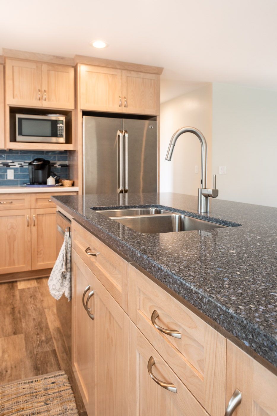Coastal Contemporary custom kitchen cabinets with natural wood stain and kitchen island sink