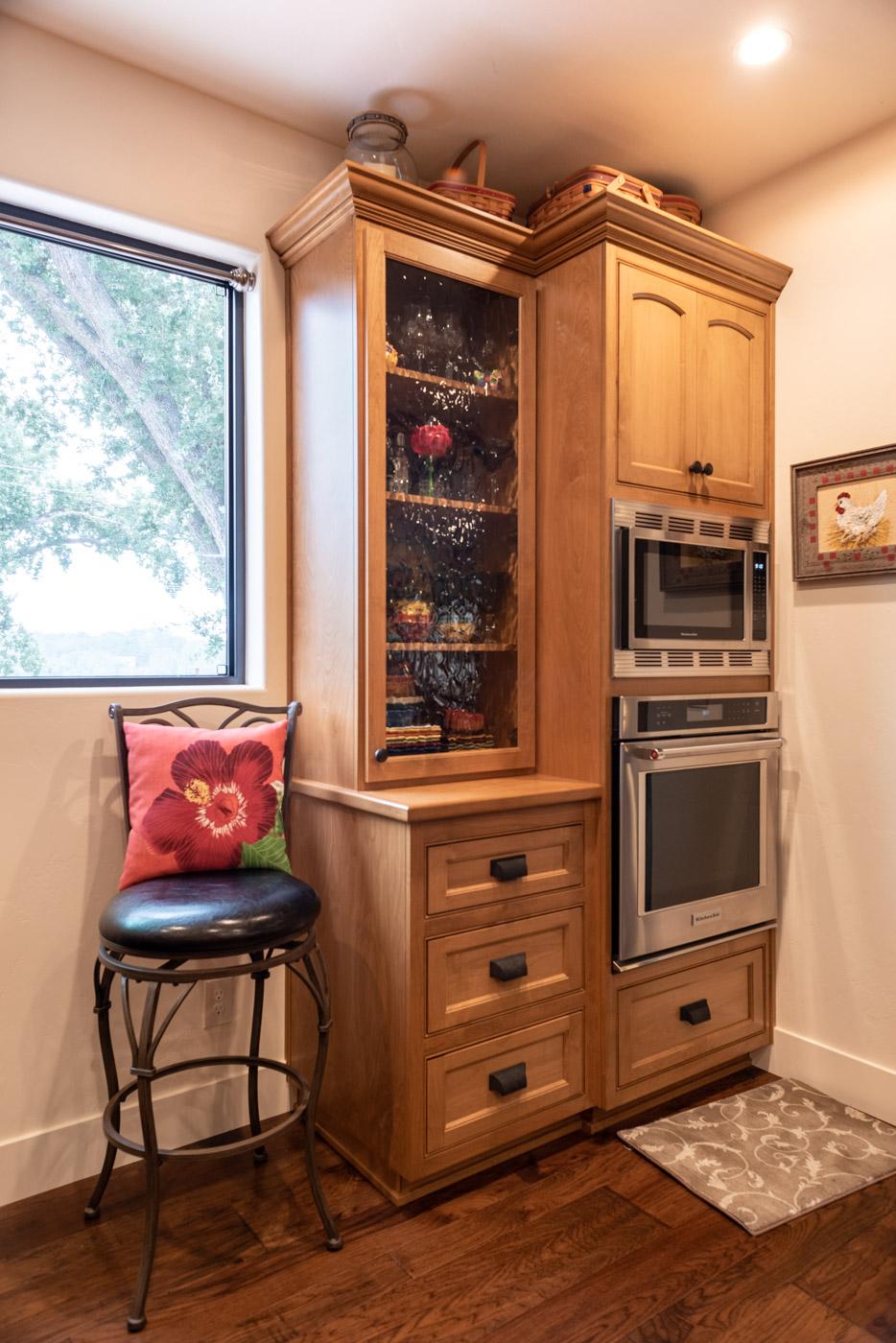 Tuscan Artisan custom stained Alder wood kitchen cabinet storage