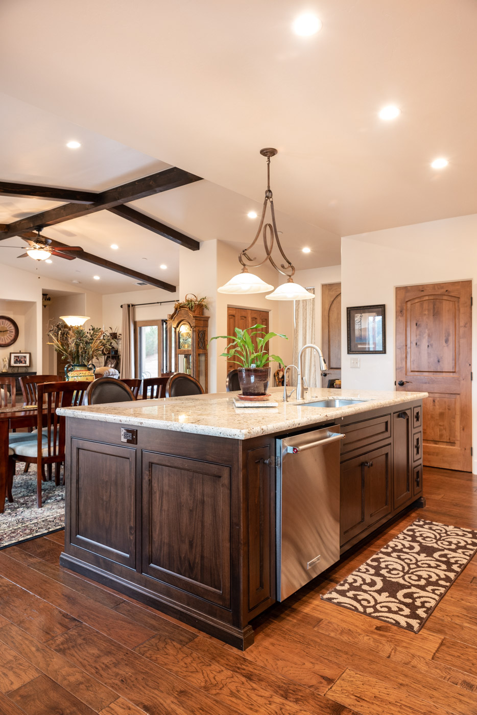Tuscan Artisan custom stained Alder wood kitchen cabinet island