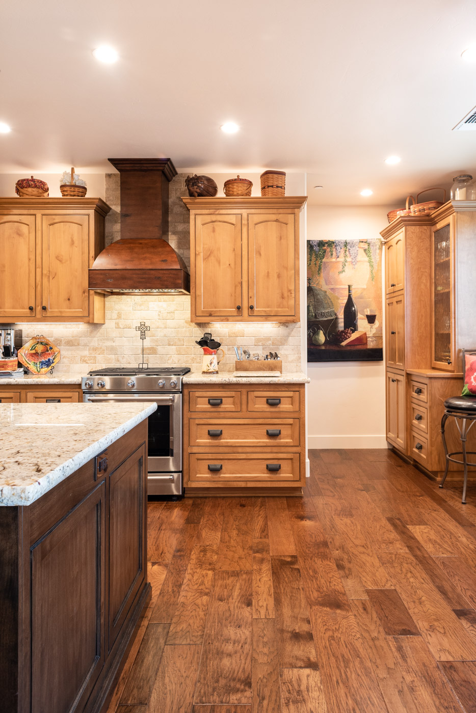 Tuscan Artisan custom stained Alder wood kitchen cabinets