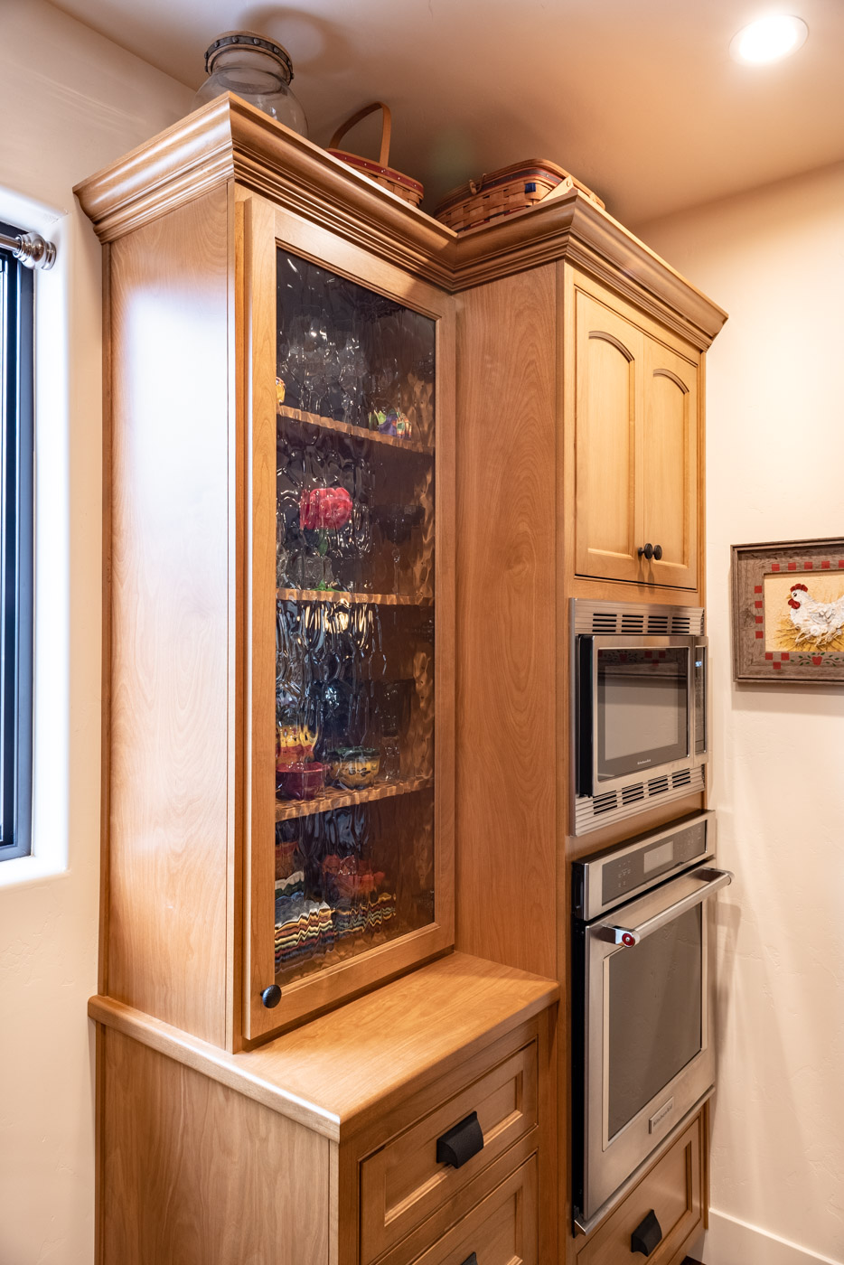 Tuscan Artisan custom stained Alder wood kitchen cabinets display