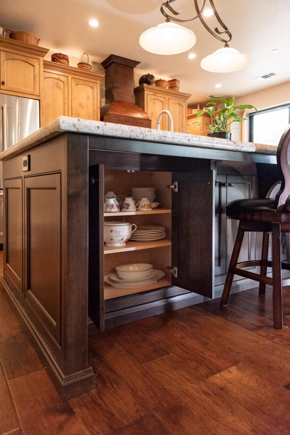 Tuscan Artisan custom stained Alder wood kitchen island storage