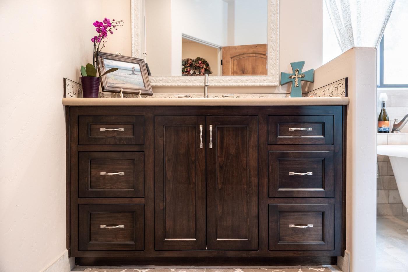 Tuscan Artisan custom stained Alder wood bathroom vanity cabinet
