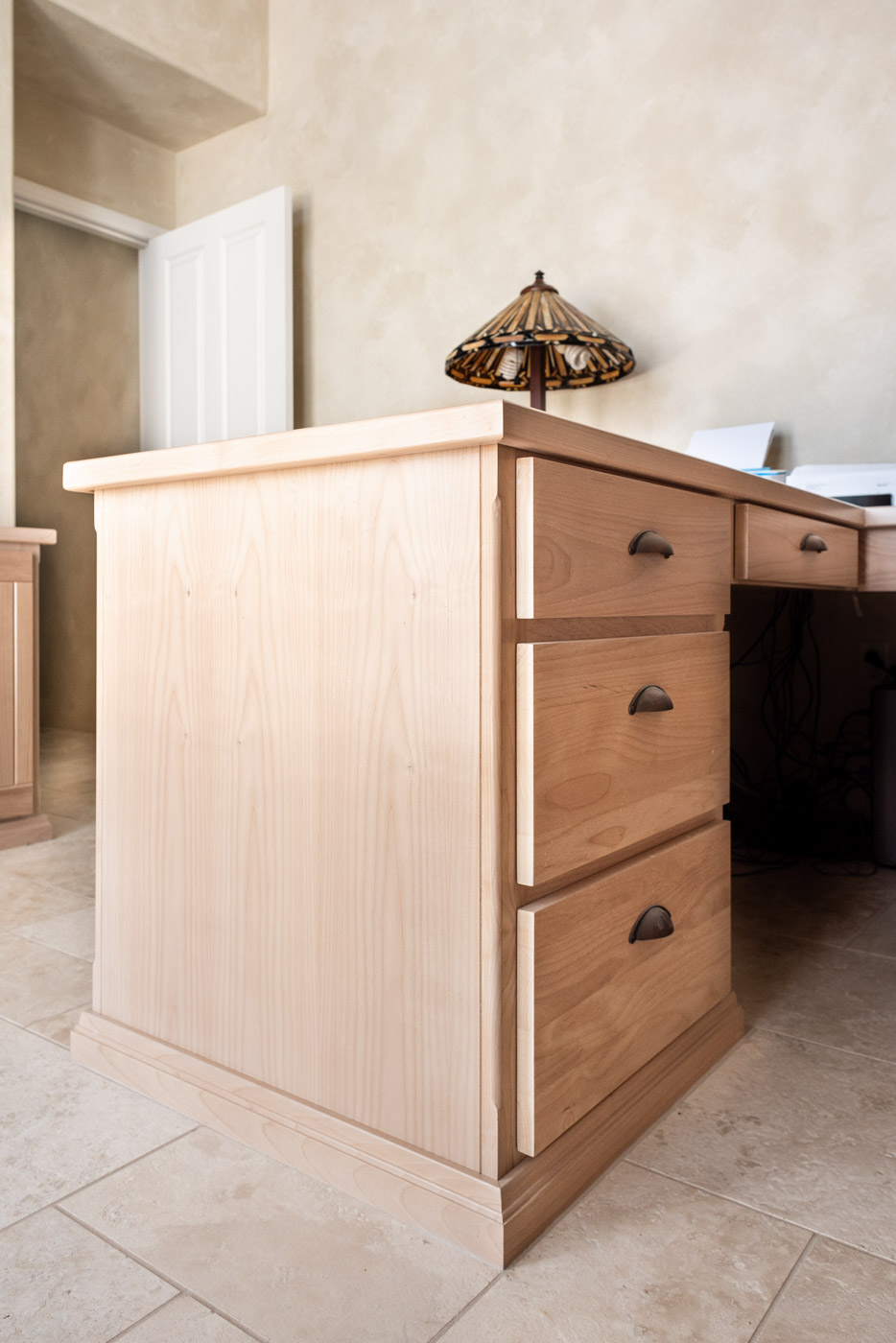 Simple Southwestern custom home office cabinets and desk in white washed wood stain