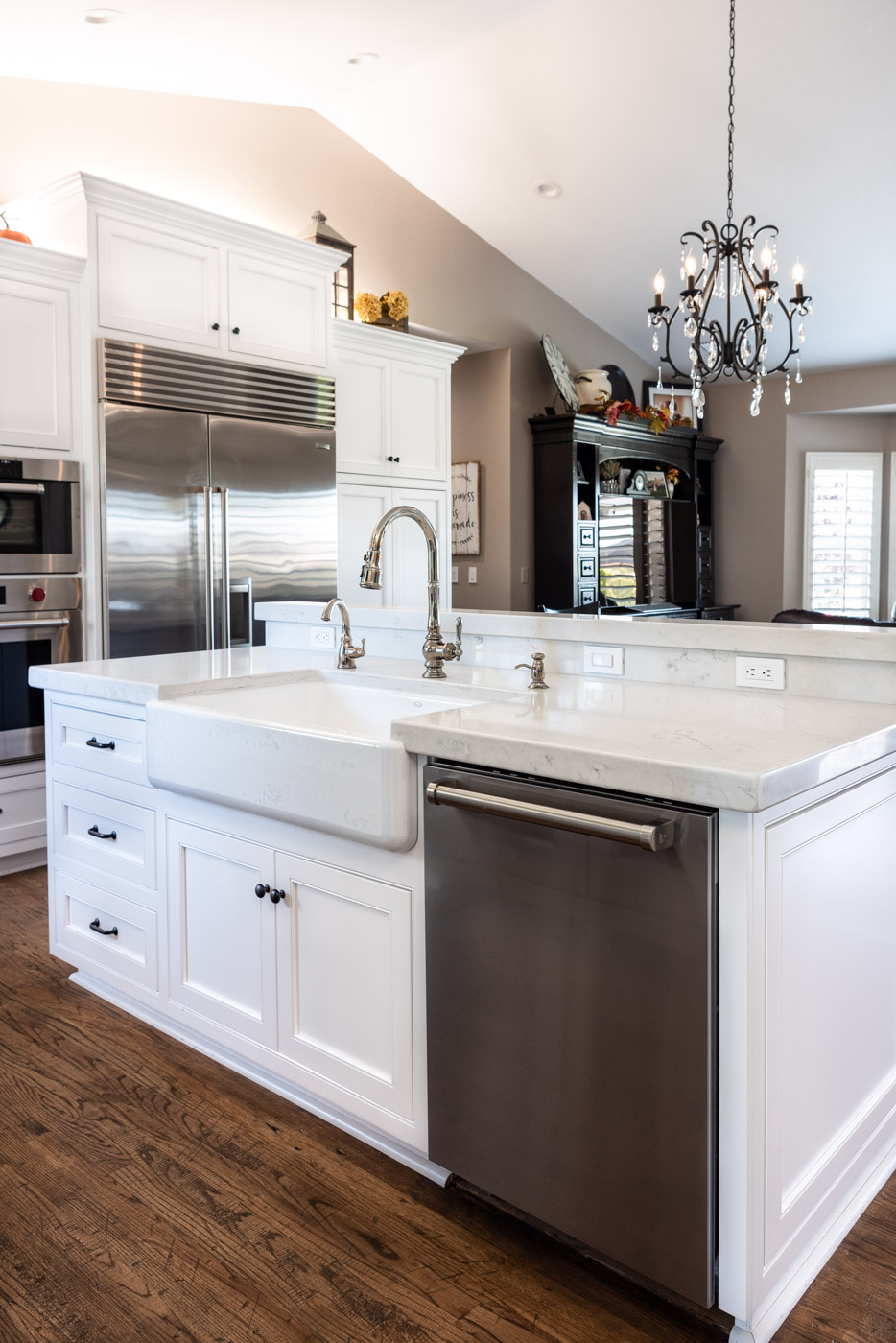 Transitional Country Cottage style kitchen with white recessed panel painted cabinets and farmhouse sink