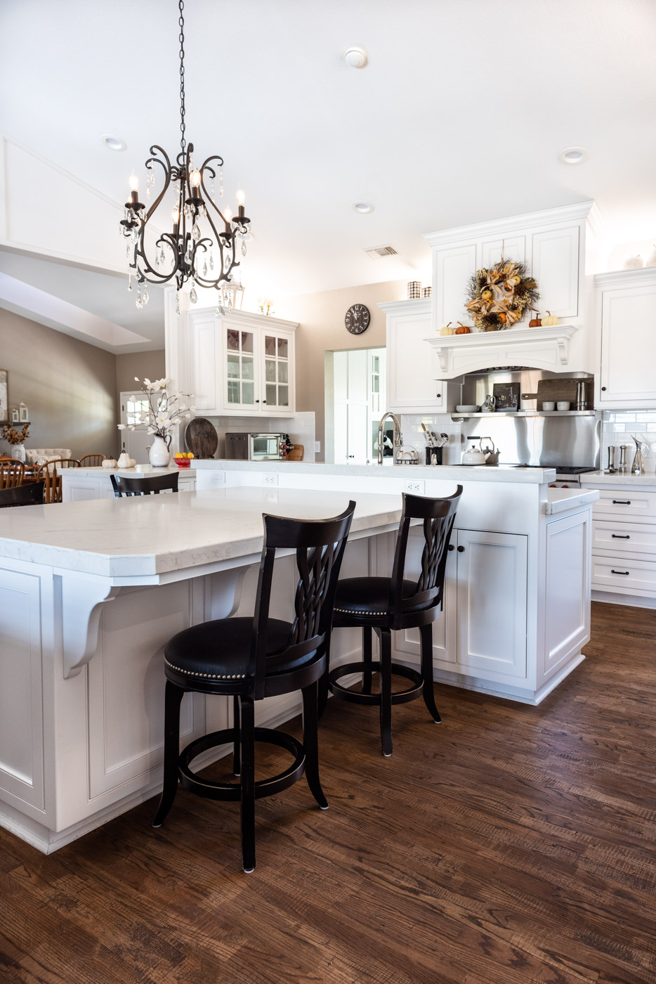 Transitional Country Cottage style kitchen with white recessed panel painted cabinets and custom kitchen island