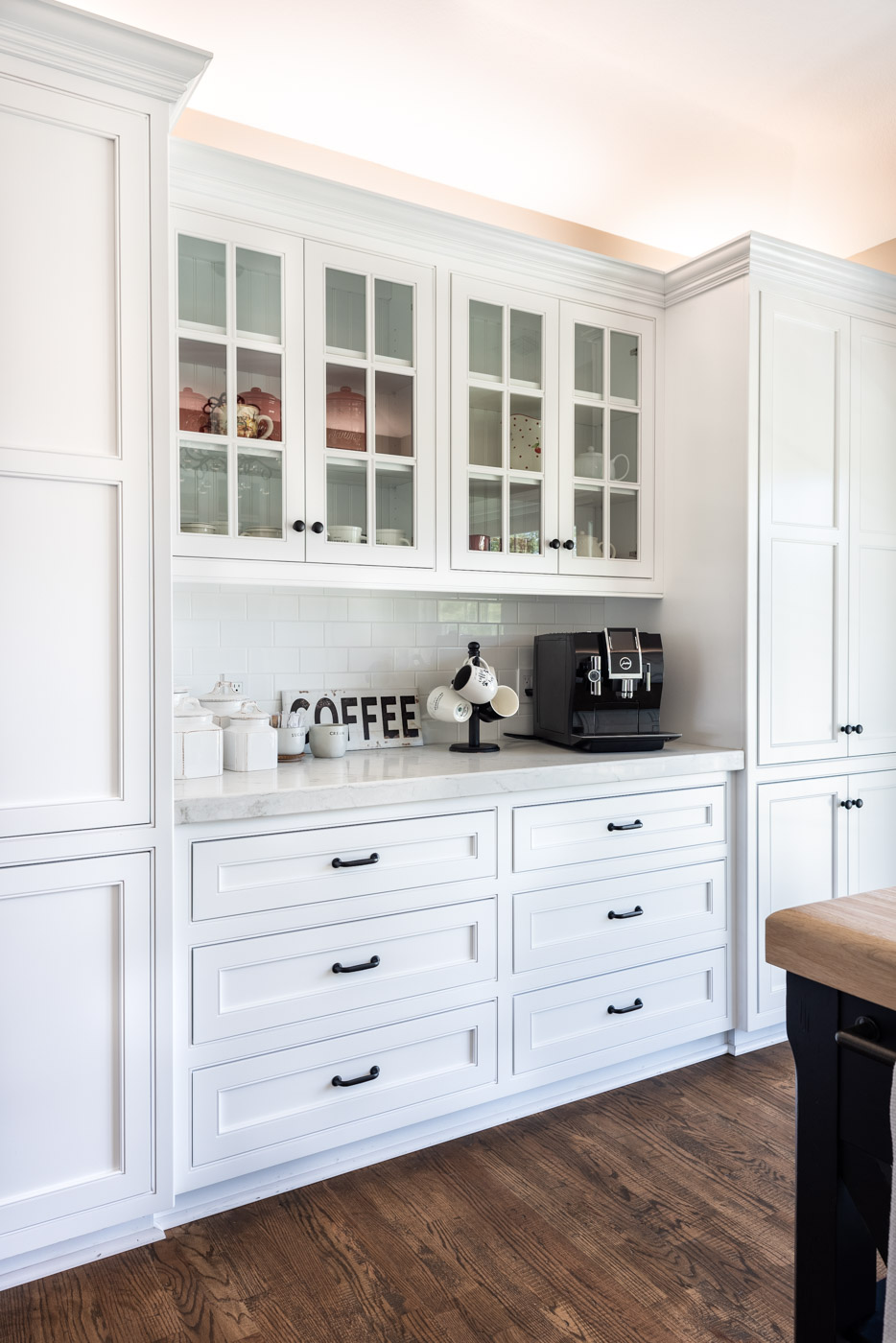 Transitional Country Cottage style kitchen with white recessed panel painted cabinets coffee bar