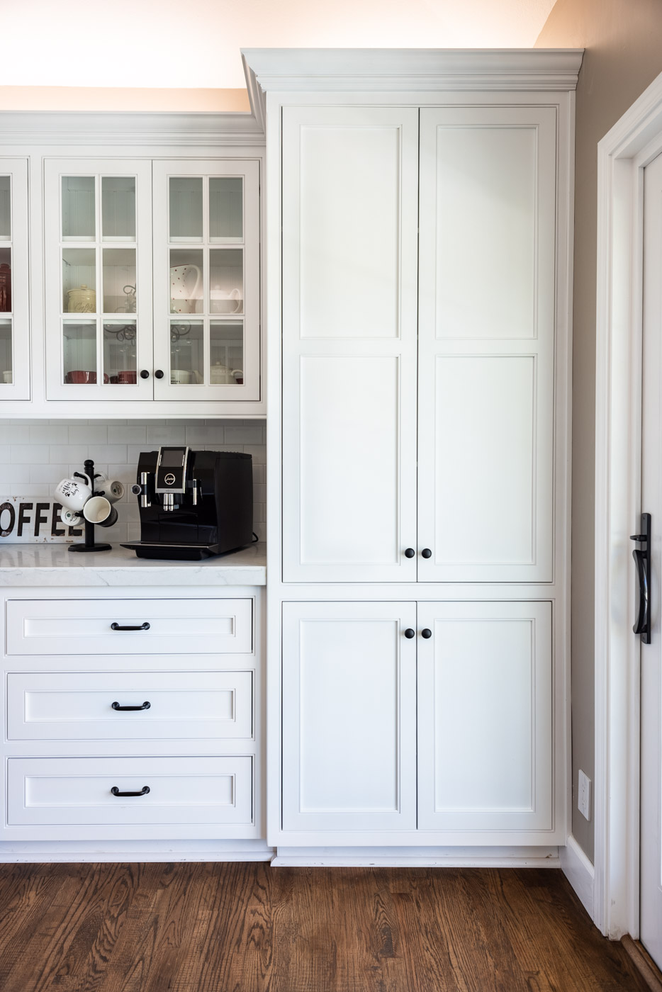 Transitional Country Cottage style kitchen with white recessed panel painted cabinets and pantry cabinet