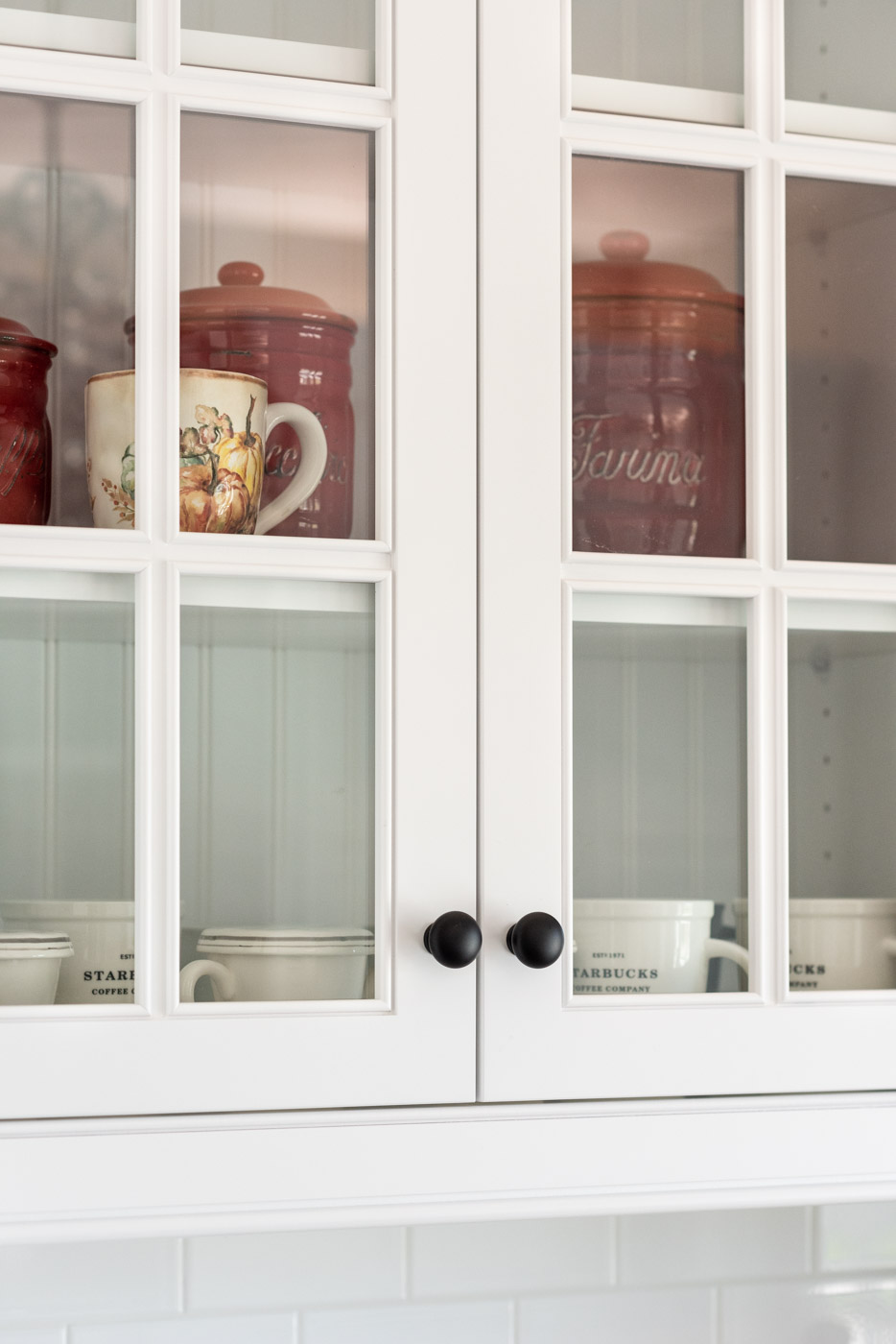 Transitional Country Cottage style kitchen with french door glass cabinet door panels