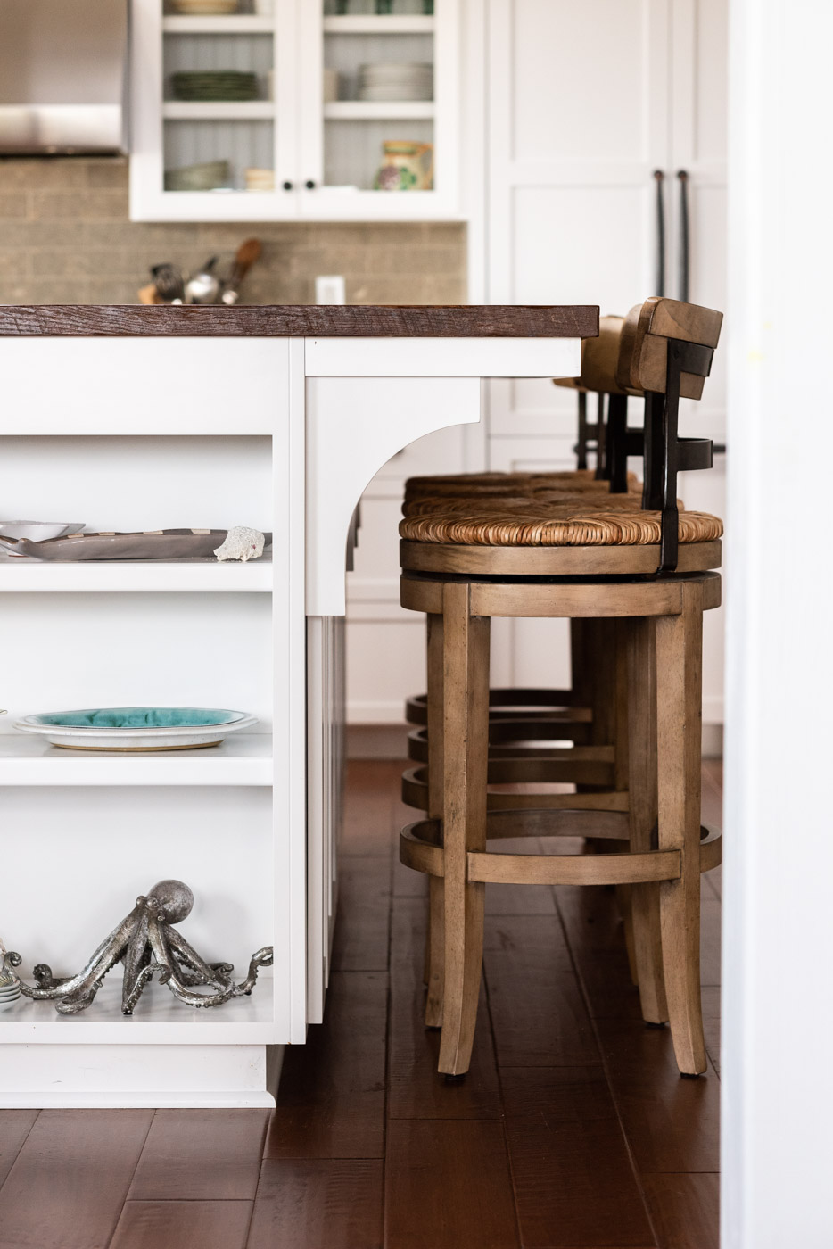 Coastal Craftsman kitchen with custom white painted shaker cabinets and island shelving