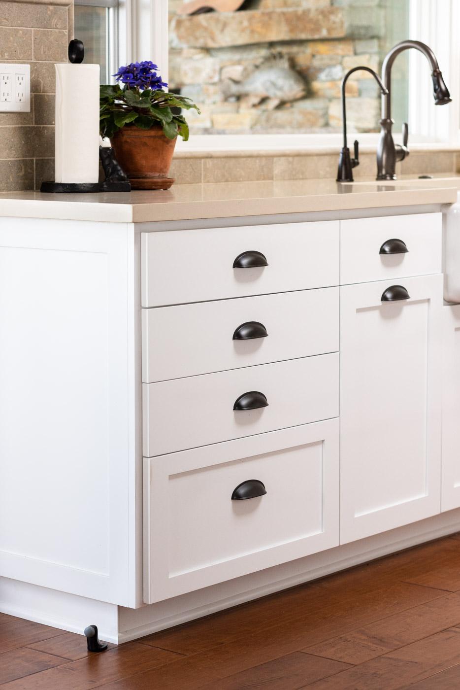 Coastal Craftsman kitchen with custom white painted shaker cabinets
