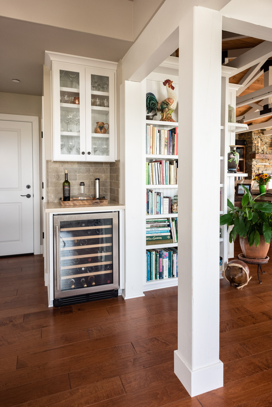 Coastal Craftsman kitchen with custom white painted shaker cabinets and home mini bar