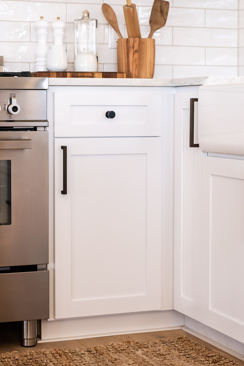 Vineyard Guest House kitchen with custom white painted shaker cabinets