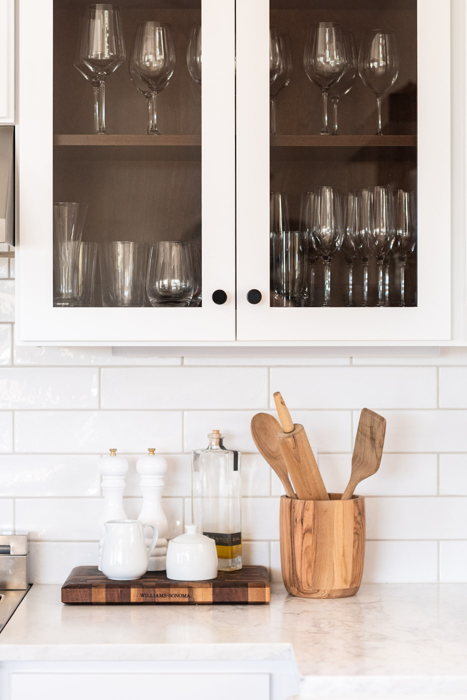Vineyard Guest House kitchen with custom white painted shaker cabinets and glass door panels