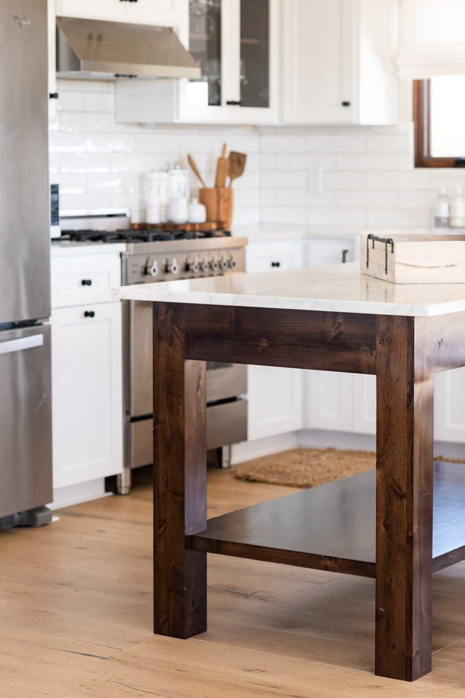 Vineyard Guest House kitchen with custom white painted shaker cabinets and free standing wood island