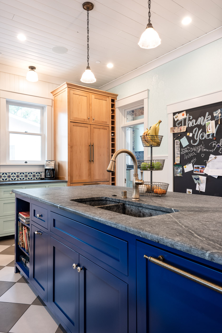 Eclectic Country Craftsman kitchen with custom blue painted cabinets and kitchen island sink