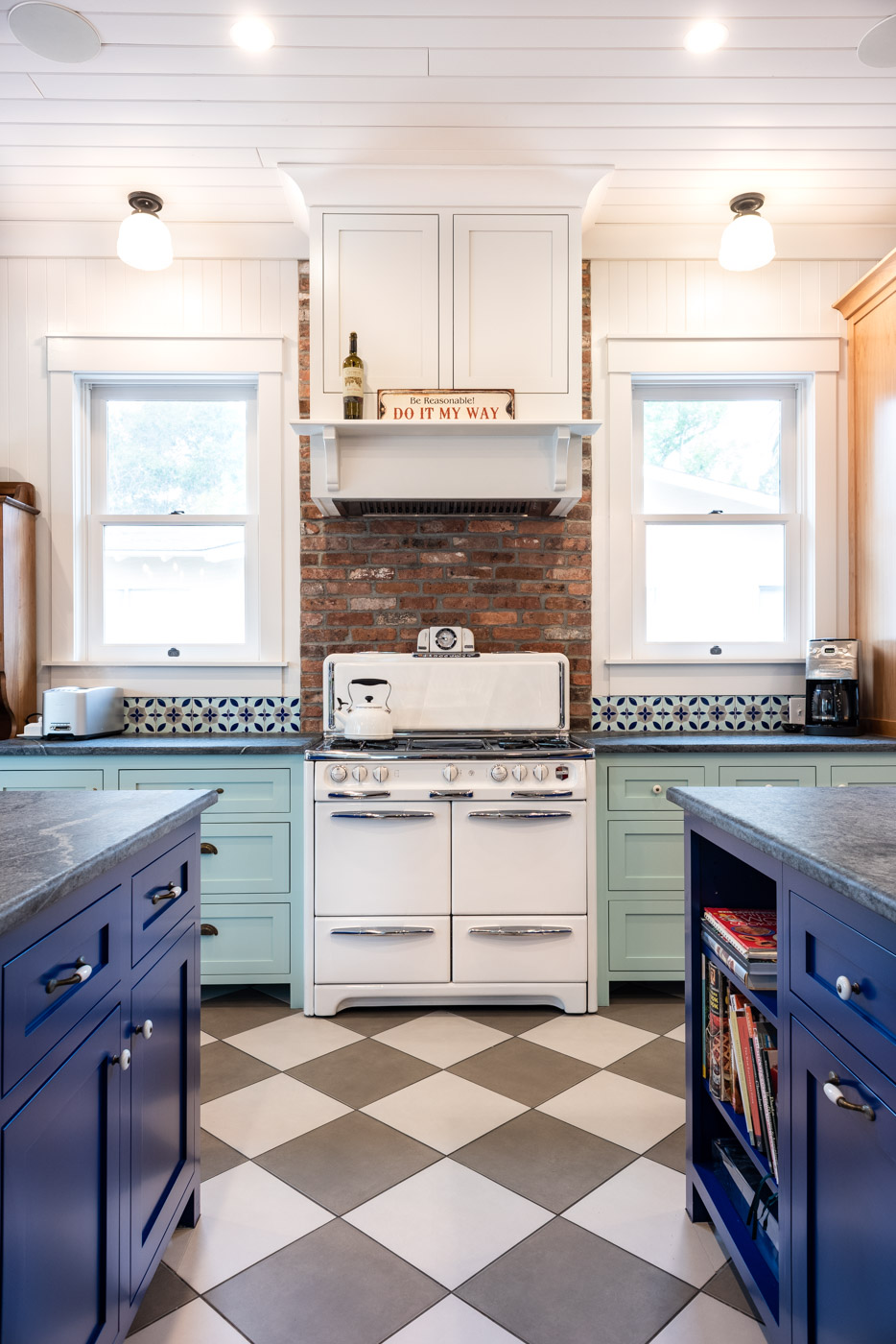 Eclectic Country Craftsman kitchen with custom blue painted cabinets and vintage stove