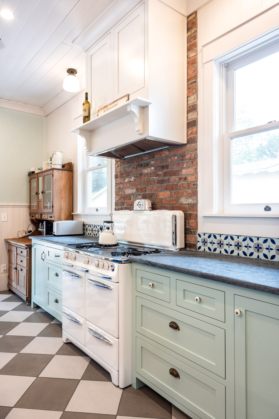 Eclectic Country Craftsman kitchen with custom blue painted cabinets and custom range hood
