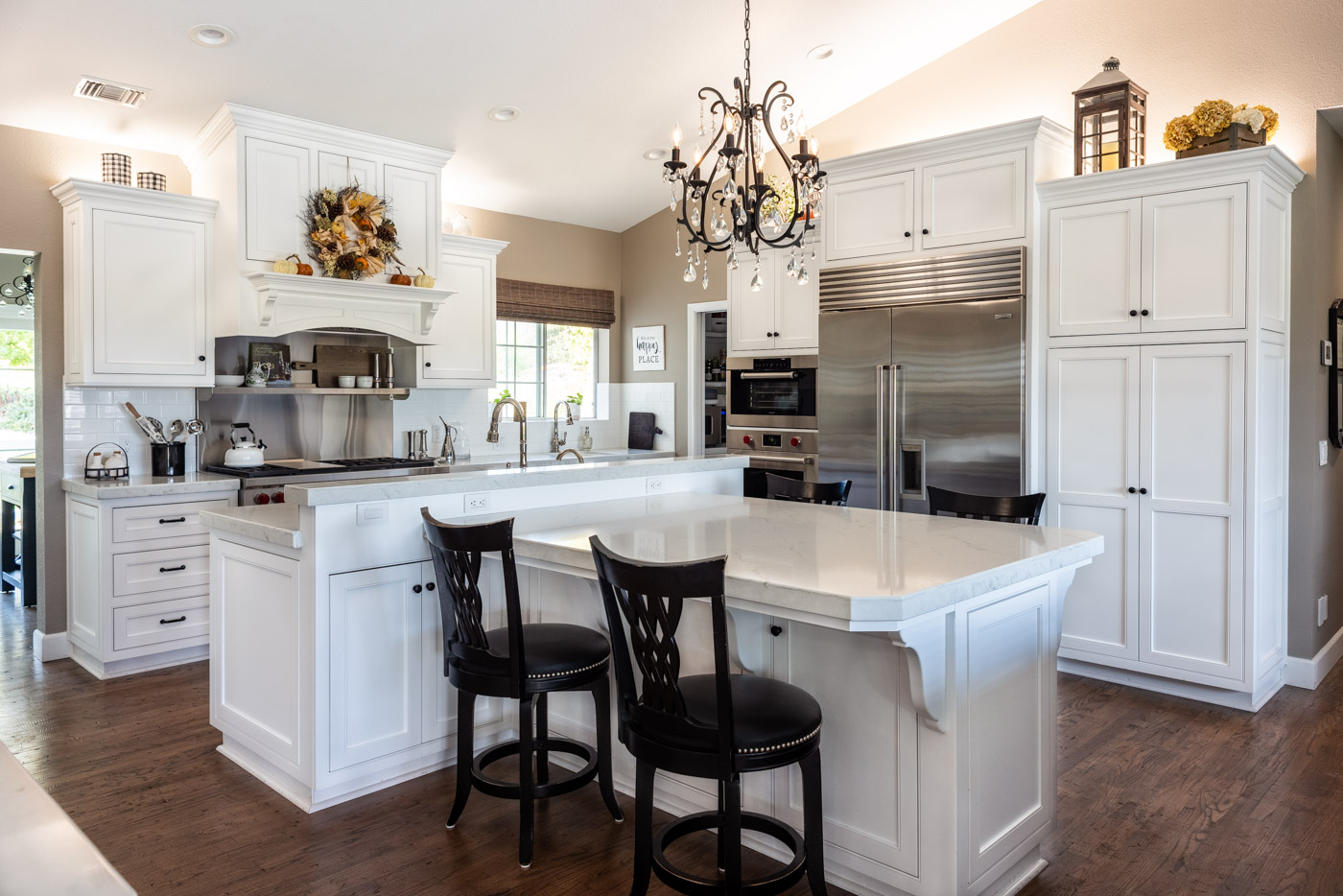 A Transitional white kitchen with custom painted small bone flush inset cabinets and stainless steel appliances