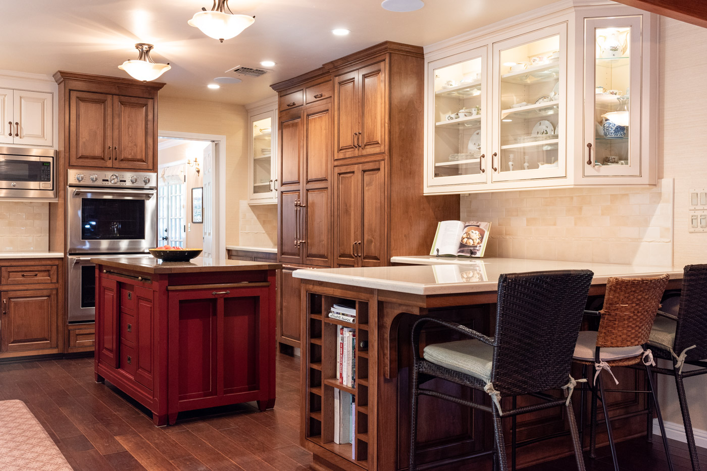 English Country custom kitchen cabinets with G-shaped layout and mixed cabinet finishes