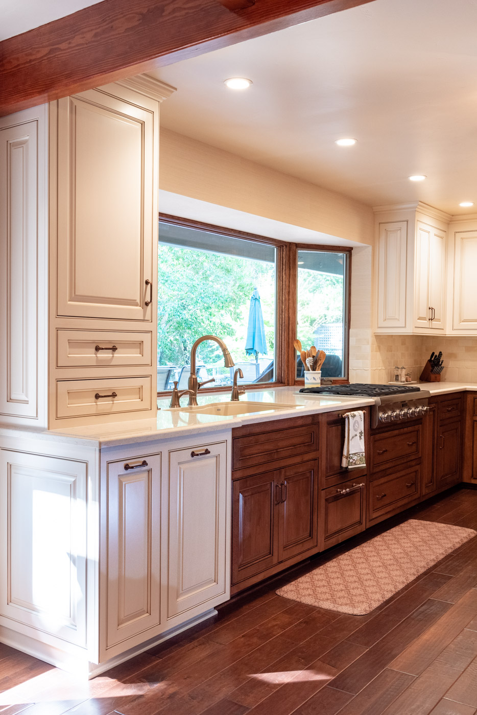 English Country custom kitchen cabinets with painted and wood stain cabinet finishes