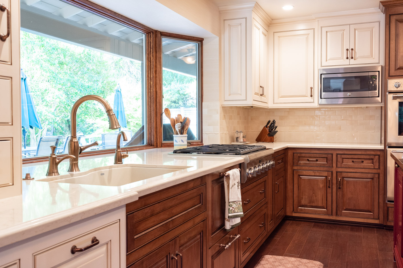 English Country custom kitchen cabinets with white painted cabinets and wood stain cabinets
