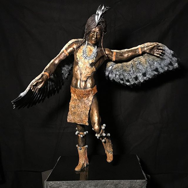 "Way-Shower Eagle Dancer 36"" H x 36"" W x 16"" D  Way-Shower Eagle Dancer was originally going to be Icarus from Greek mythology who made wings of wax and feathers and flew toward the sun only to have them melt plummeting him into the sea drowning. As I continued to sculpt him it became evident that another Native American was being formed and I had the foundation of an Eagle Dancer. Way-ShowerEagle Dancer emerged with his Wings in flight and his leg raised executing the movement of an Eagle Dancer. I'm very happy with the outcome, I think he's magnificent! #sculpture #danromerosculpture #nativeamerican #portraitsculpture #bronzesculpture #originalart #sculpting #artist #bronzeartist #artgallery #lagunaart #nativeamericanart #instaart #1001sculptures #scottsdaleart"