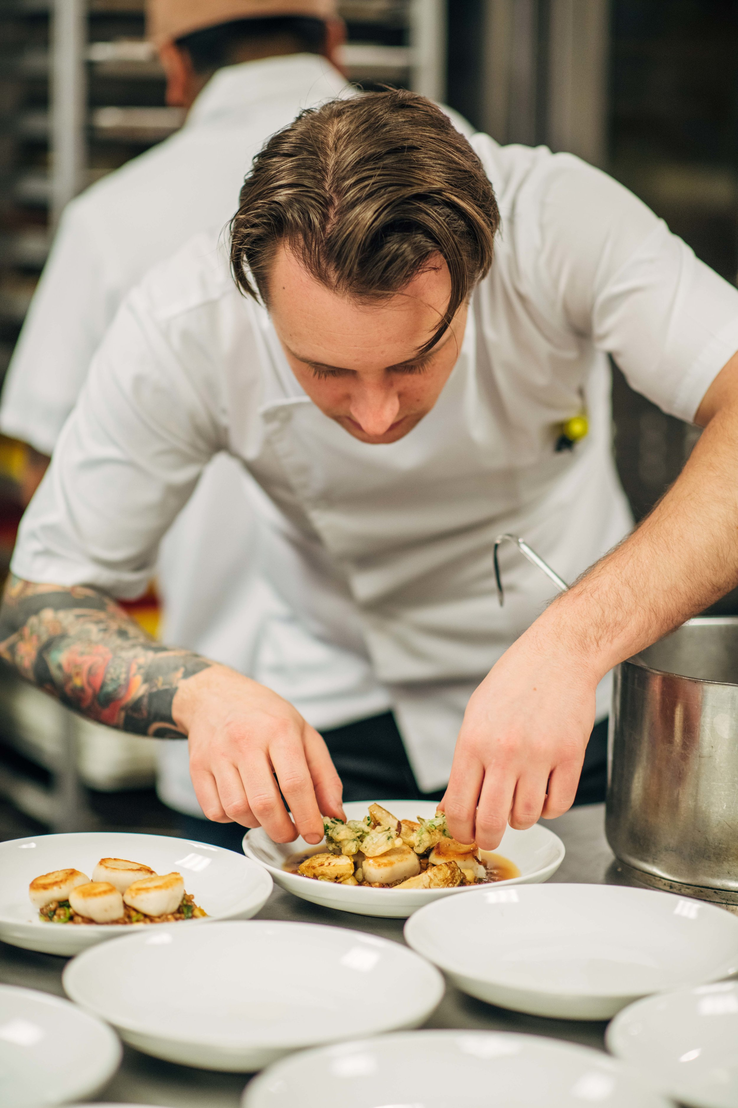 Chef Christopher Cryer plates up the first course. Photo by Christian Rodriguez.
