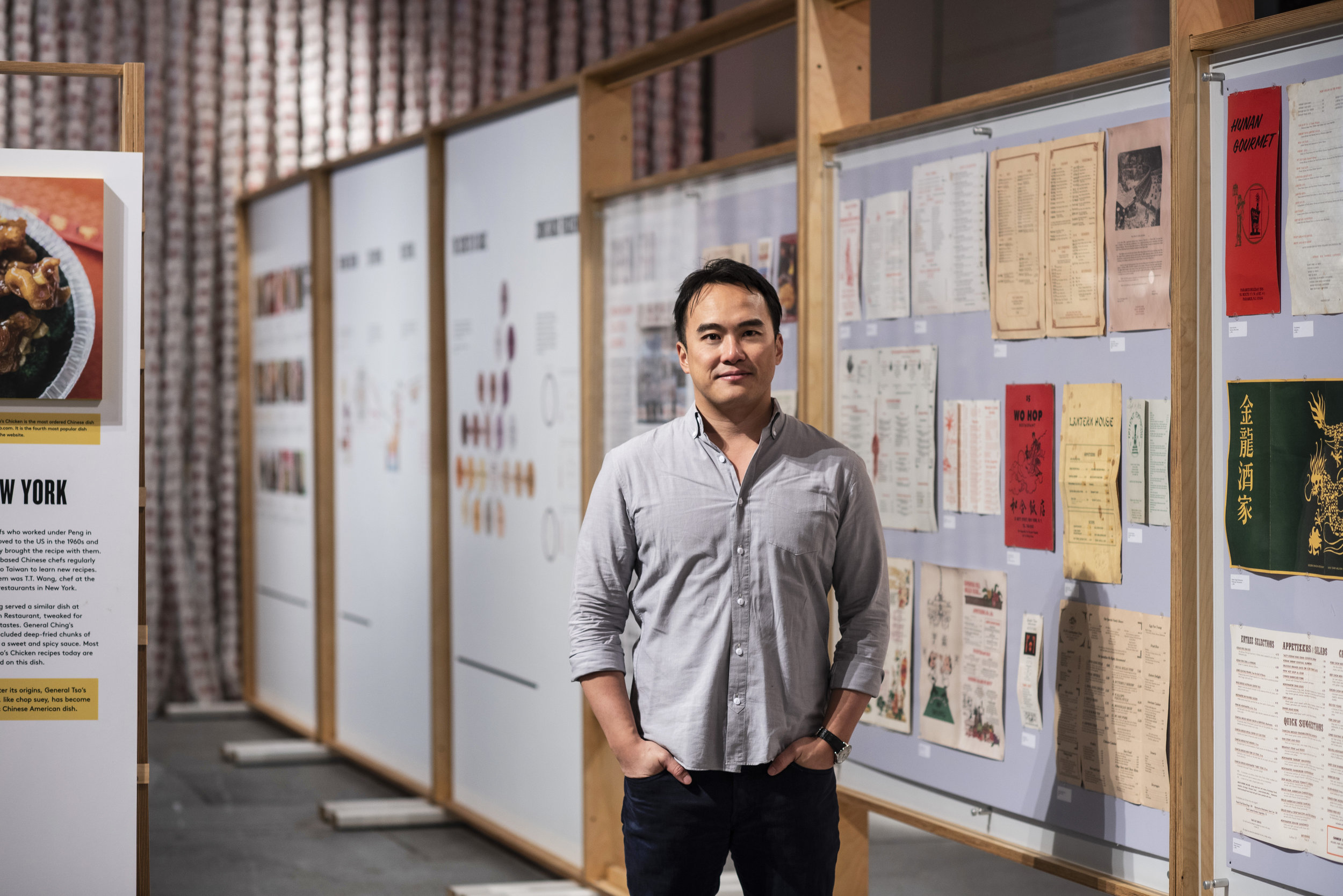 Mike Lee with menus from his family's restaurants at the MOFAD exhibit. Photo by  Liz Clayman .