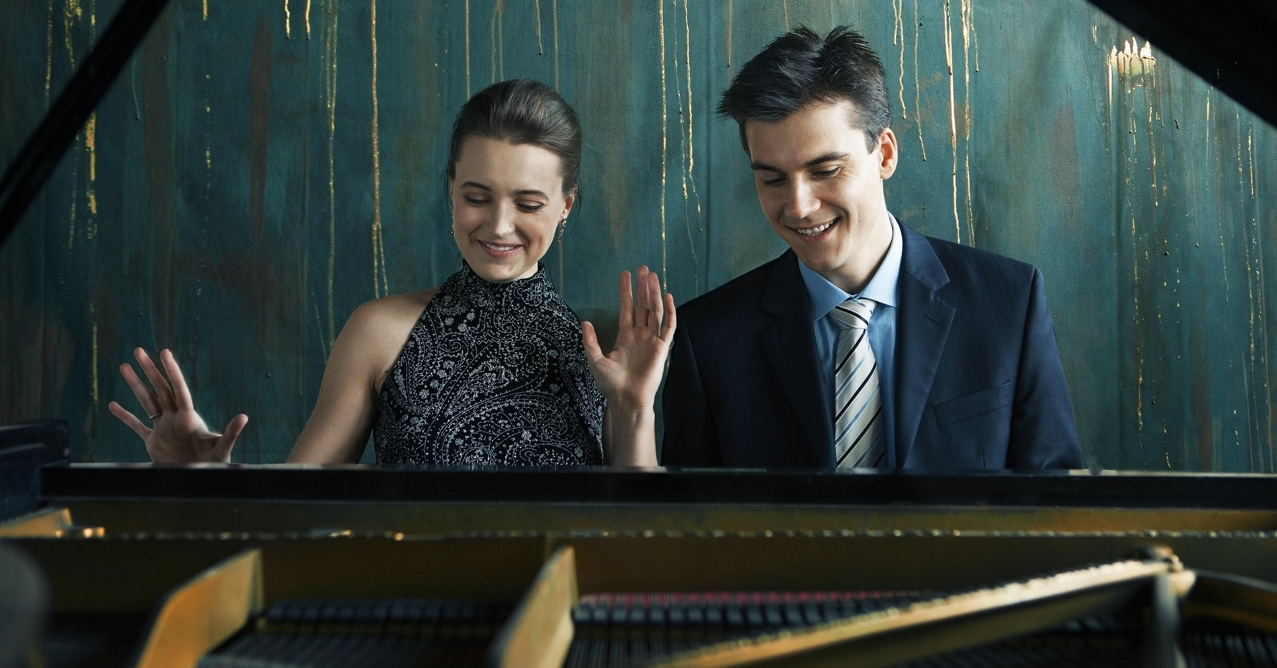 "Praised for their ""stirring performances of rare repertory"" (Fanfare Magazine), Shelest Piano Duo is a husband and wife team of Anna and Dmitri Shelest that takes their roots to the music school in Ukraine. At their official Carnegie Hall debut in February 2018, their CD Release of  Ukrainian Rhaosody  brought the renewed attention to the music of their homeland. Since then, the CD has been featured as the Album of the Week on a number of radio stations nationwide (KUSC Los Angeles, WCRB Boston, etc.) Having been classmates since middle school, the Duo began performing together after their marriage in the US. Their inventive programs brought them to a broad array of venues from concert stages to state functions, and, in words of Secretary-General of the United Nations Ban Ki-moon ""realized diplomacy through music."""