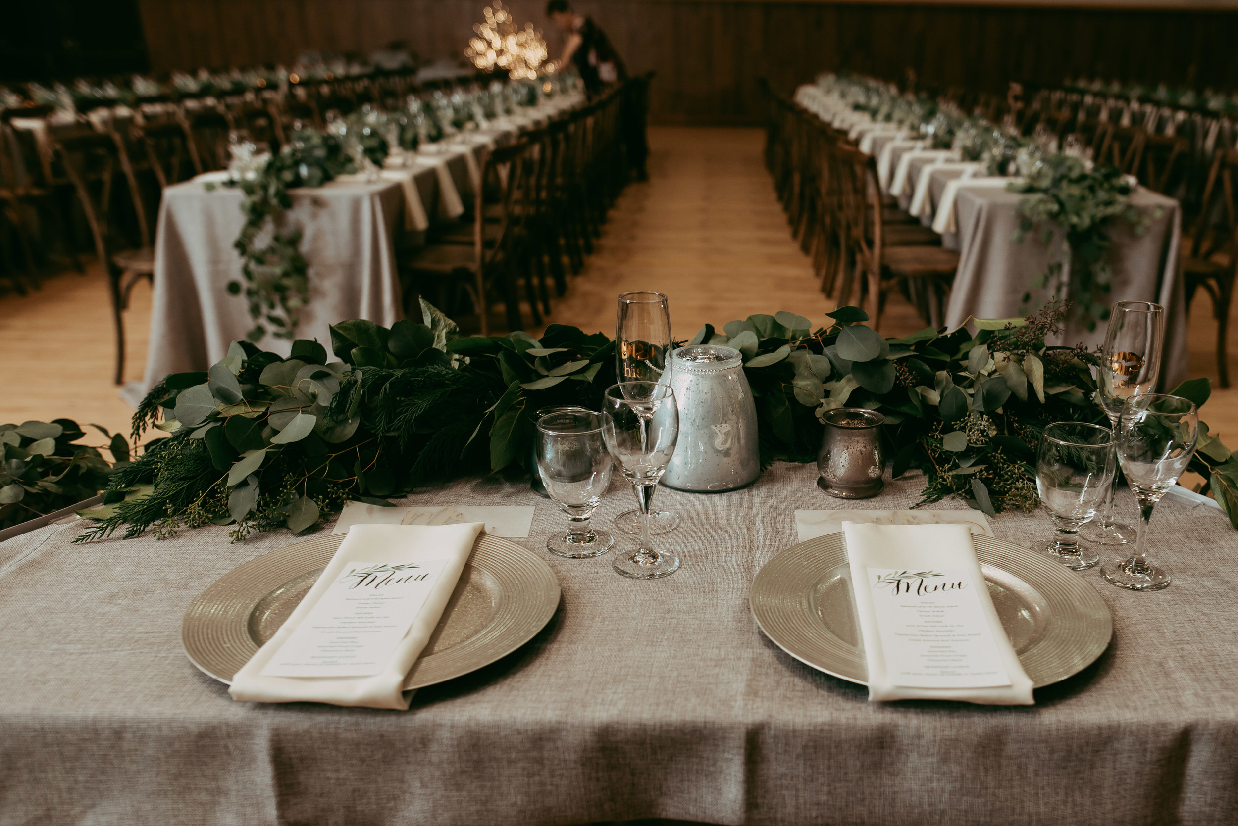 Elegant Greys - A candlelight reception endures timeless beauty; light grey hues amidst flowing greenery added to the romantic ambiance of this beautiful day. The ceremony had rustic charm with a beautiful backdrop of the Leduc Stone Barn.Photography: Jaymarie StudiosView Gallery>
