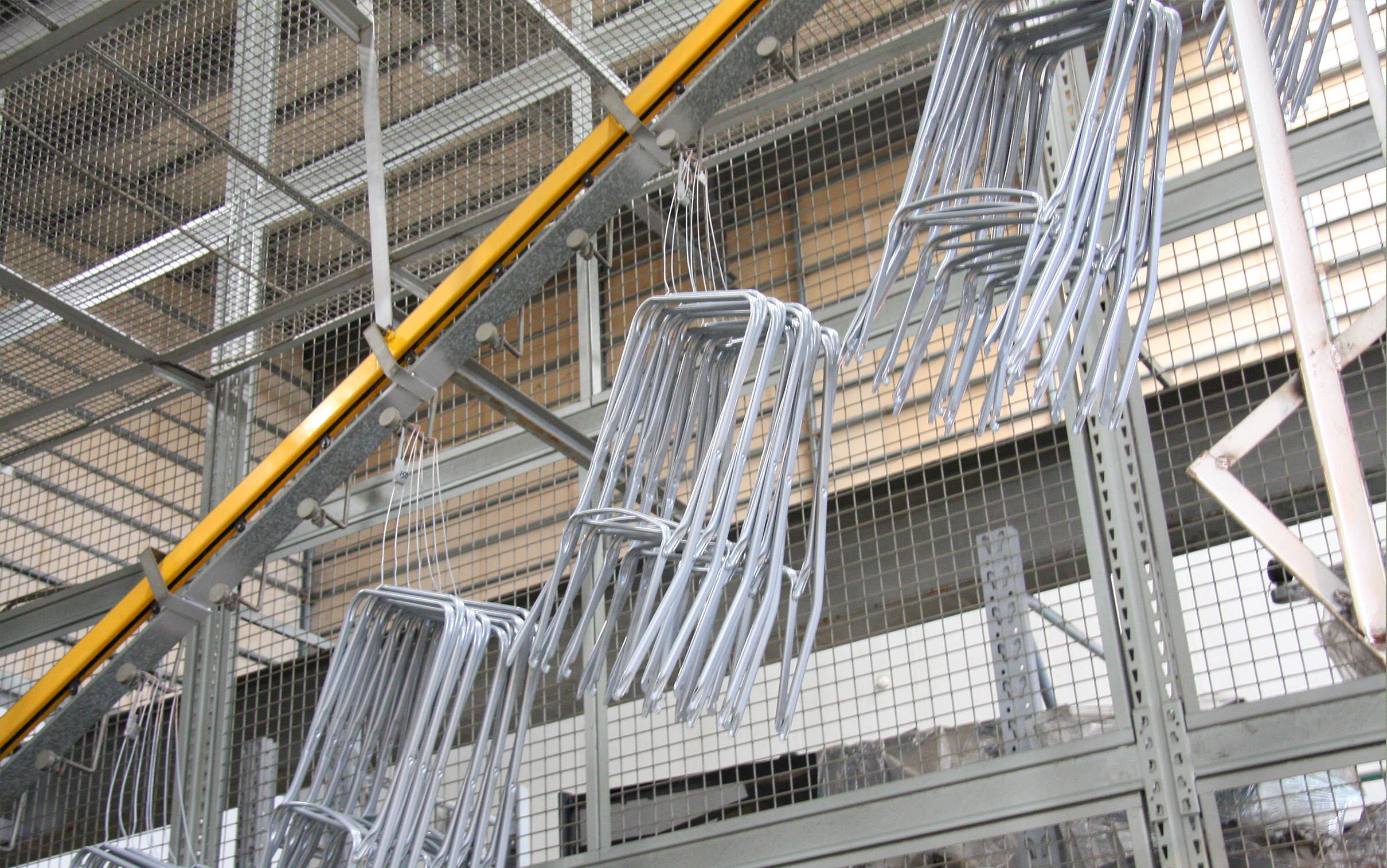 Sky Storage - With our sky storage system, parts can remain untouched and unharmed before entering the assembly and packing line.