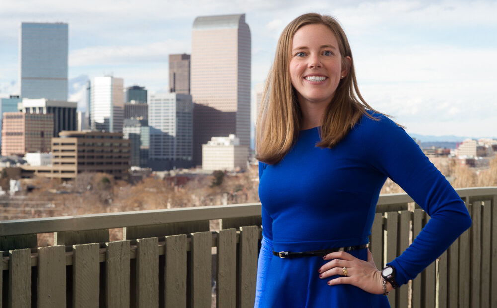 Elena Harman profile shot with Denver in the background