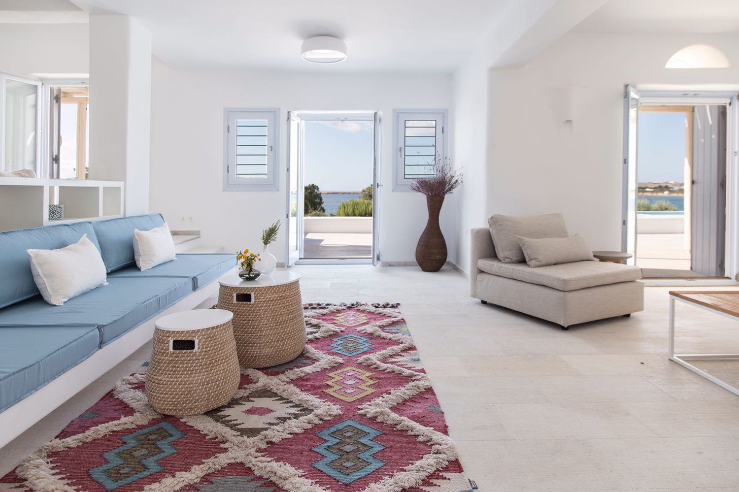 Traditional rugs look great in greek island house.
