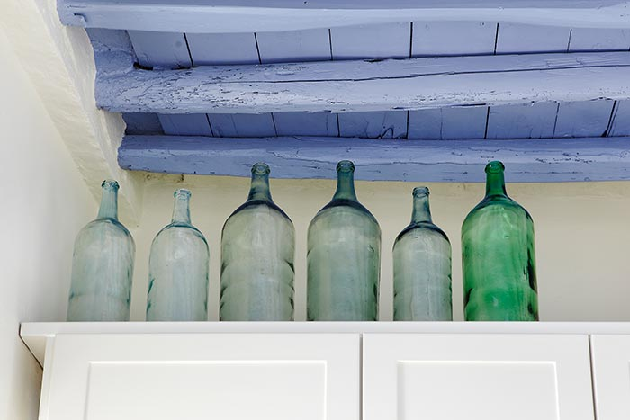 If you are brave enough paint the ceiling blue to achieve a greek islands style look.