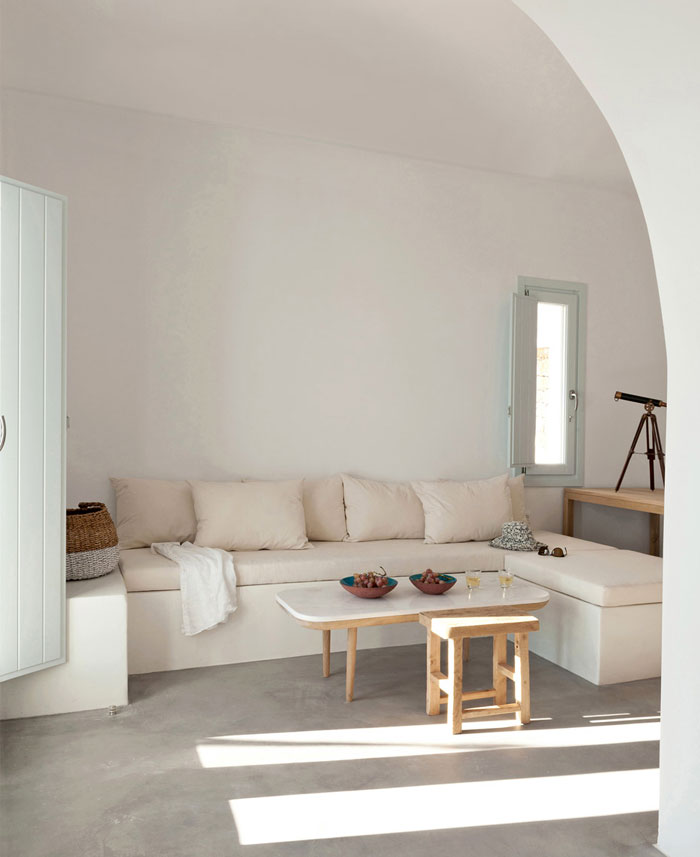 Greek islands style living room with built in sofa and minimalist style.