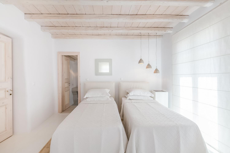 Minimalist greek islands style bedroom.