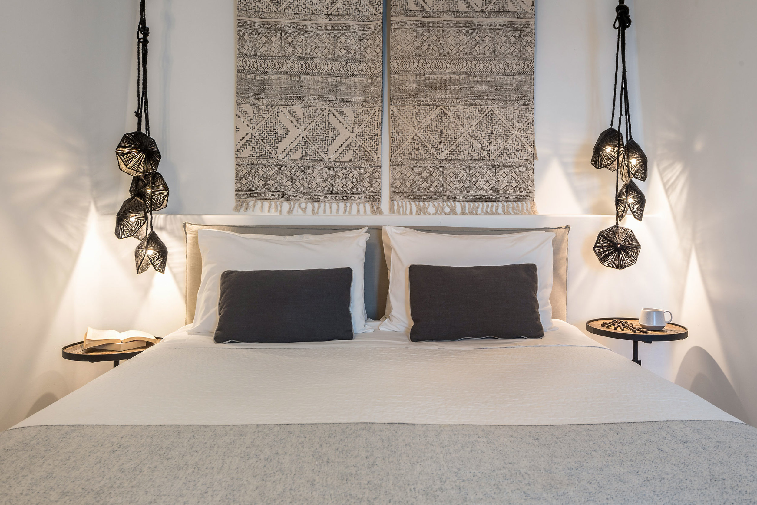 Greek island style bedroom with ethnic and modern details.