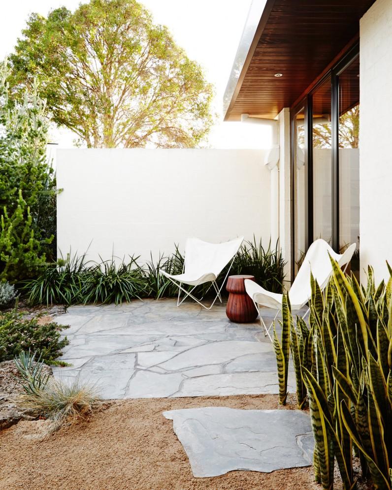 white-butterfly-chairs-in-garden.jpg
