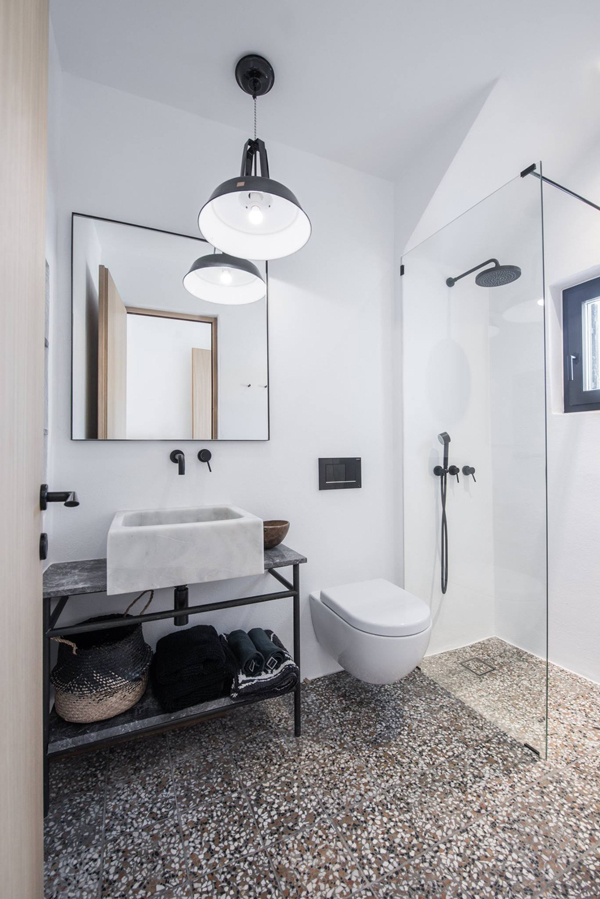 Grey terrazzo tiles in the bathroom of a summer house on a greek island