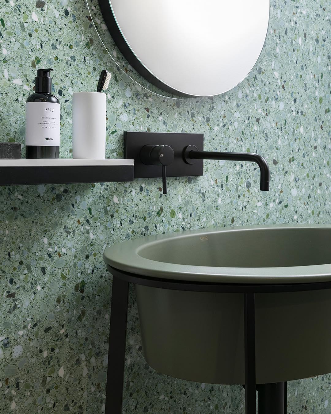 Bathroom with green terrazzo wall