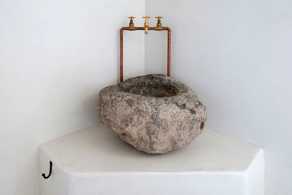 Stone sink in greek island bathroom