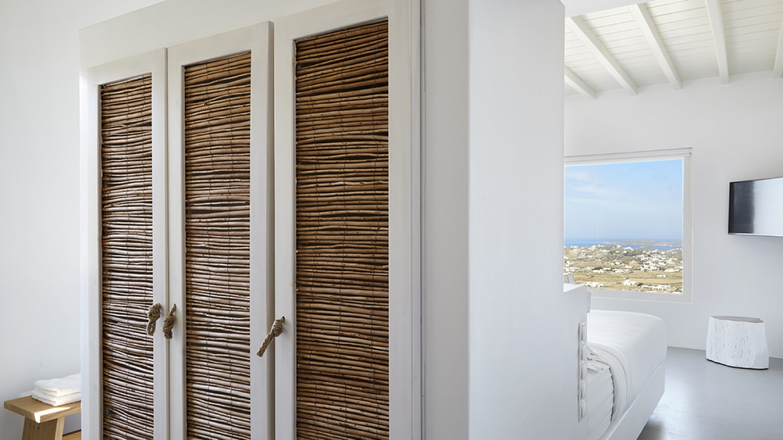 Cane wardrobe in greek island style house