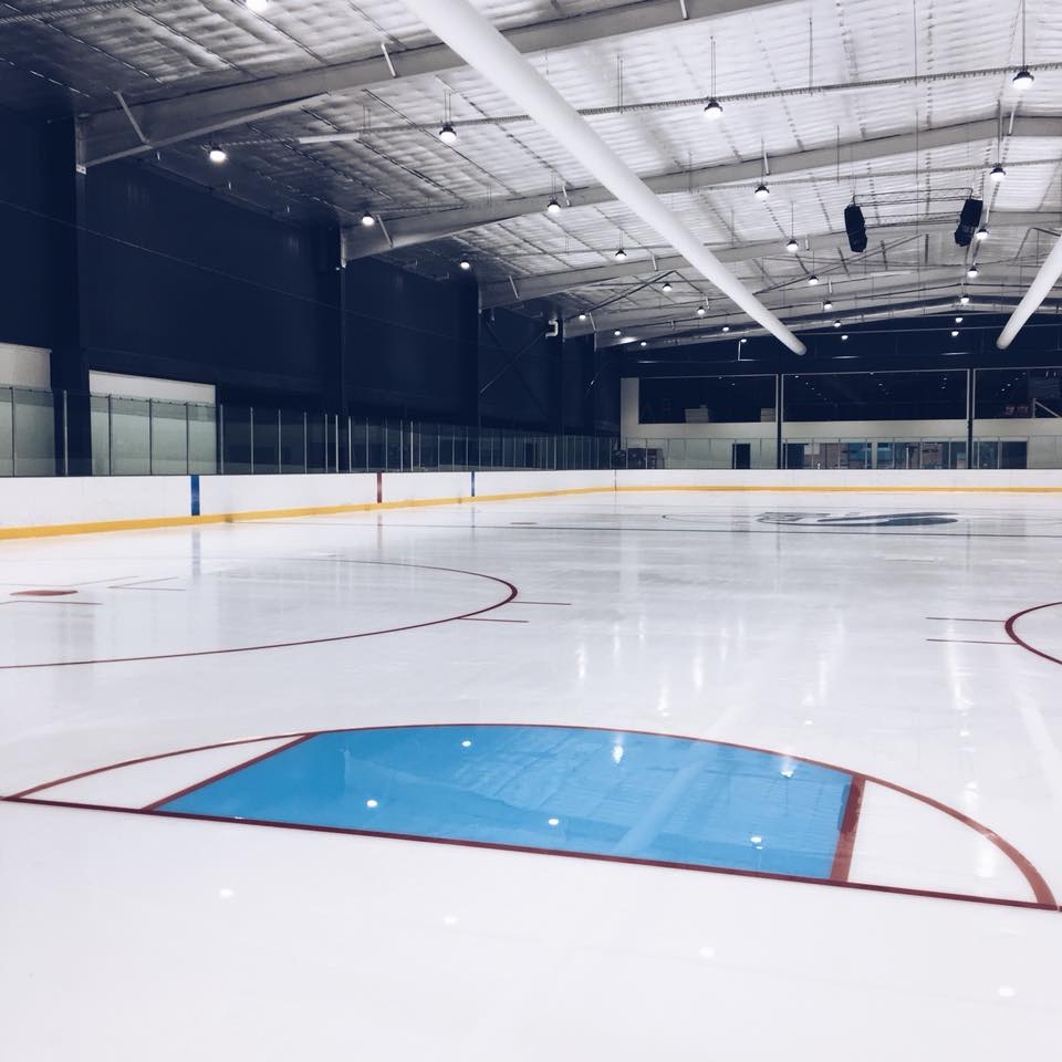 view of iceHQ ice hockey rink from behind the goal crease