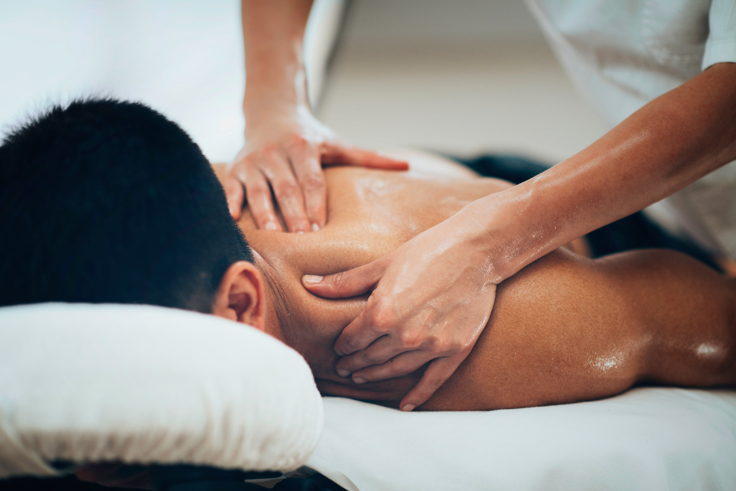 deep tissue massage   involves applying firm pressure and slow strokes to reach   deeper   layers of   muscle   and fascia (the connective   tissue   surrounding muscles).It's used for chronic aches and pain and contracted areas such as a stiff neck and upper back